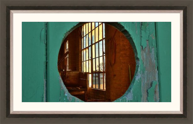 Peering through a small barn door porthole into the old Power Building at Harlinsdale Farm in Franklin, Tennessee