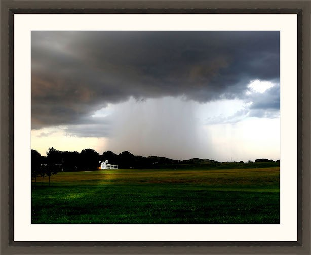 A rain shower spreads over Harlinsdale Farm, Franklin, Tennessee.